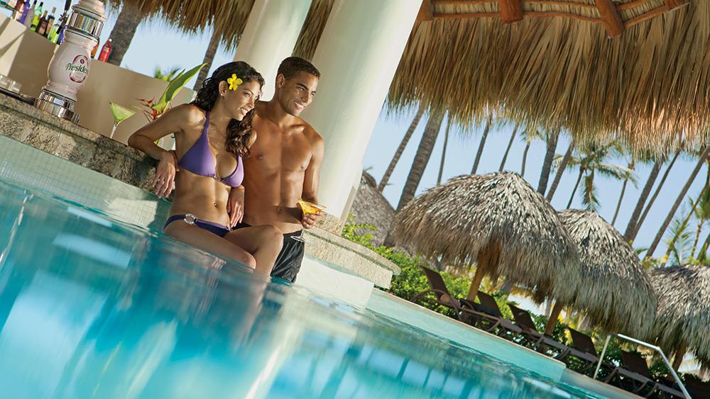 Couple at the swim up bar at Secrets Royal Beach