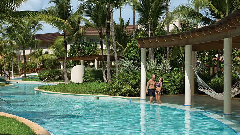 Couple standing in the pool at Secrets Royal Beach