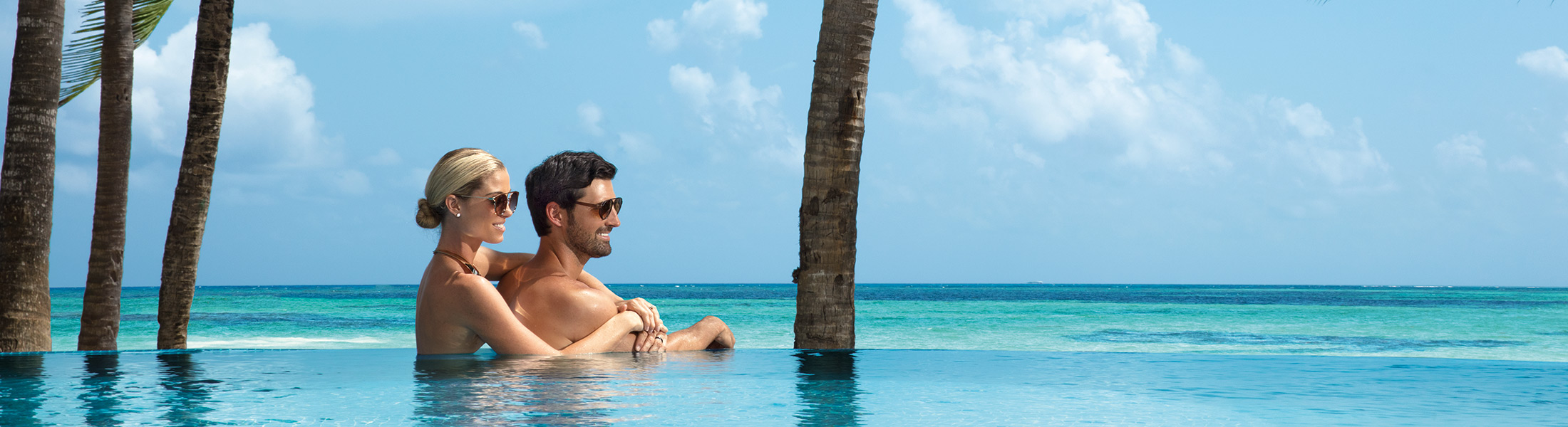 Couple at the edge of the infinity pool at Zoetry Montego Bay