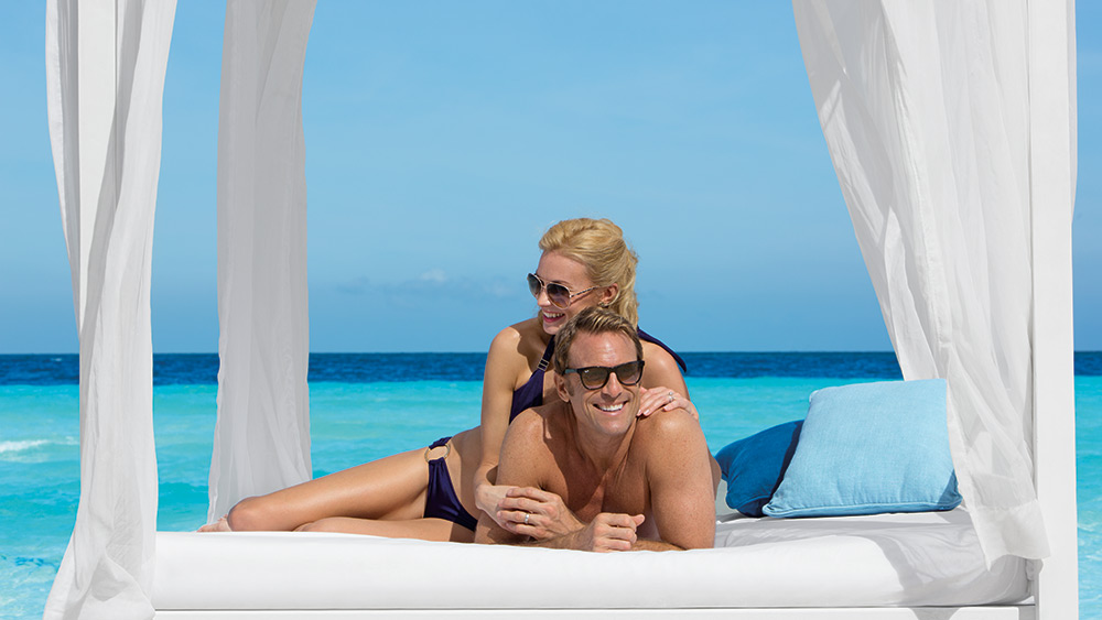 Couple in a beach cabana at Dreams Sands Cancun