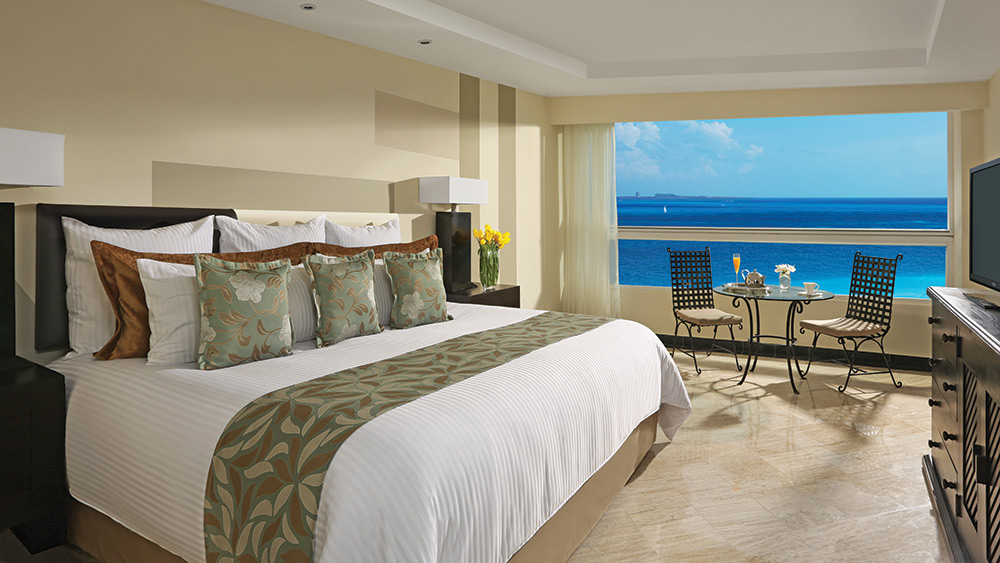 Bedroom of the Deluxe Ocean Front Room at Dreams Sands Cancun