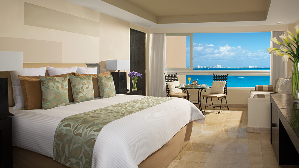 Bedroom of the Deluxe Partial Ocean View Room at Dreams Sands Cancun