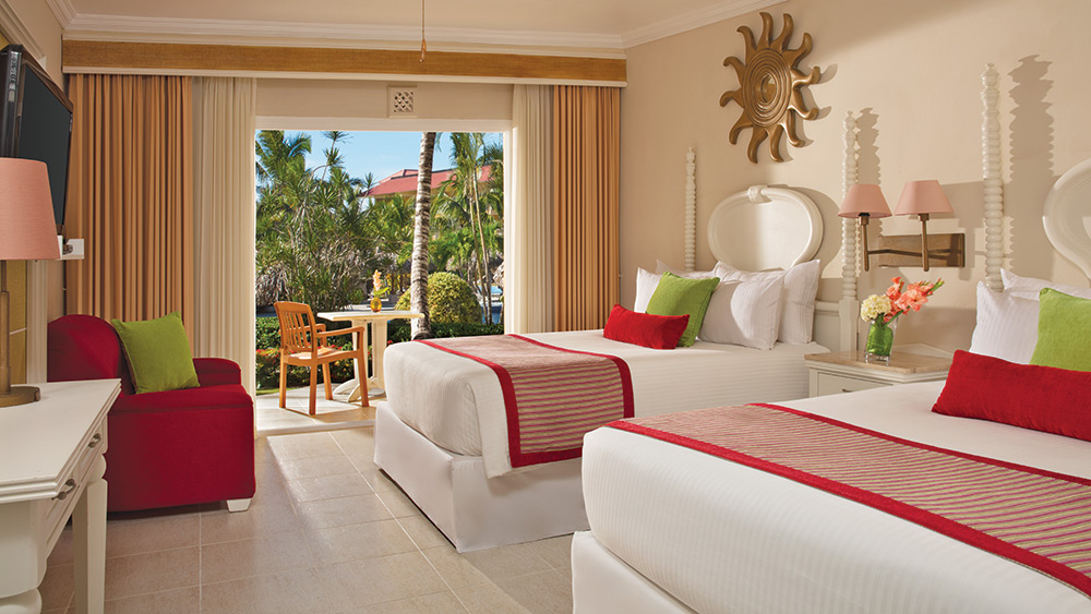Twin room of the Deluxe Tropical View Family Room at Dreams Punta Cana