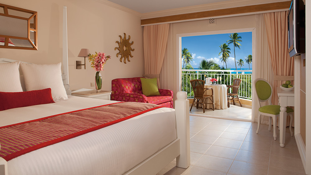 Bedroom of the Deluxe Tropical Room at Dreams Punta Cana