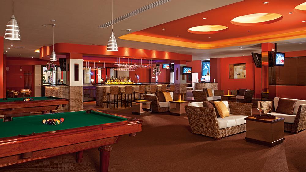 Pool table and bar at Secrets Capri Riviera