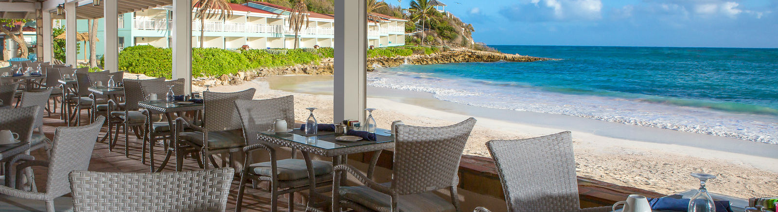 Dining lounge on the beach at the Pineapple Beach Club, Antigua