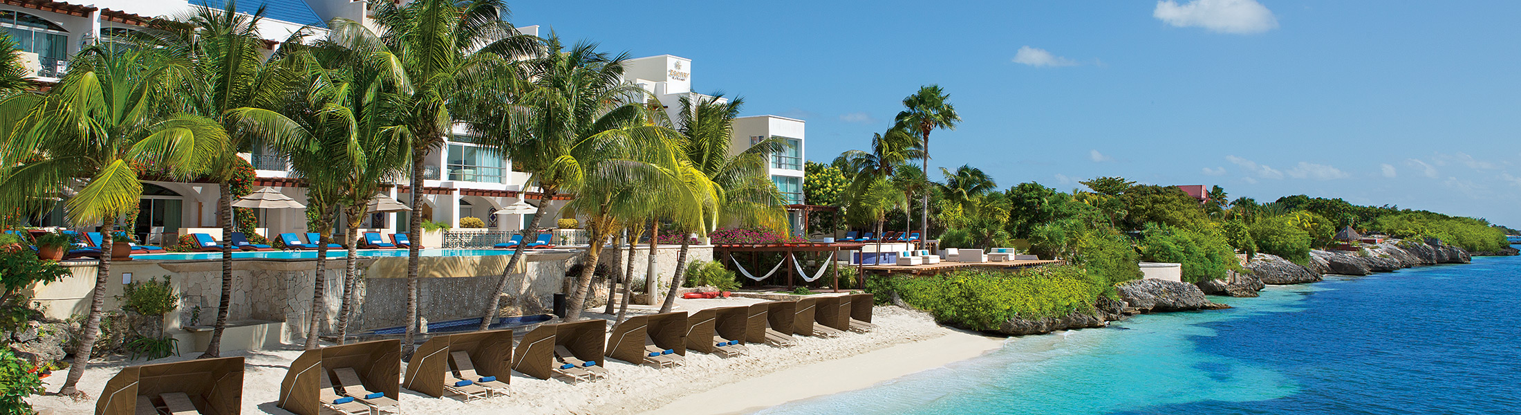Beach with sun loungers at Zoetry Villa Rolandi Isla Mujeres