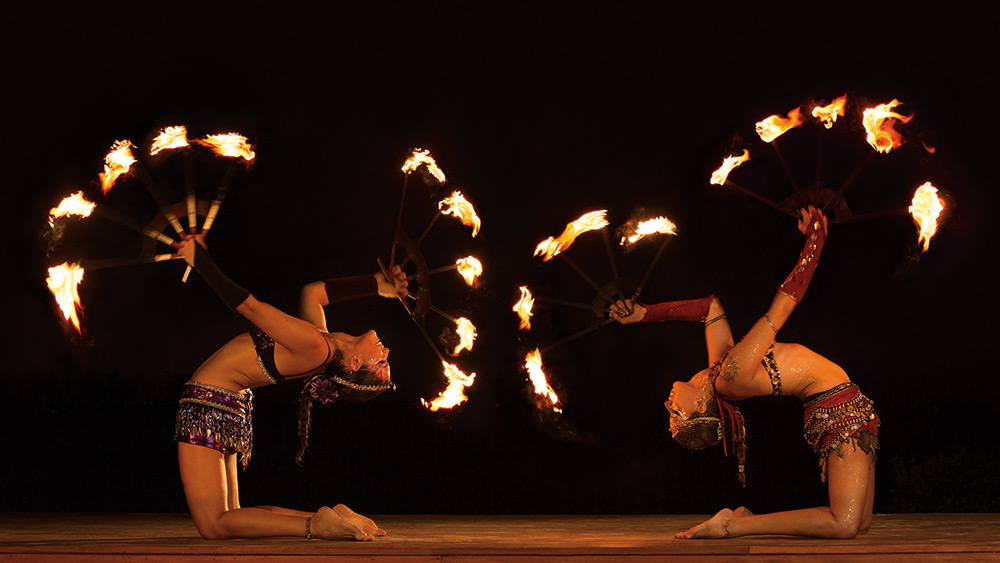 Two fire twirlers at Dreams Sands Cancun