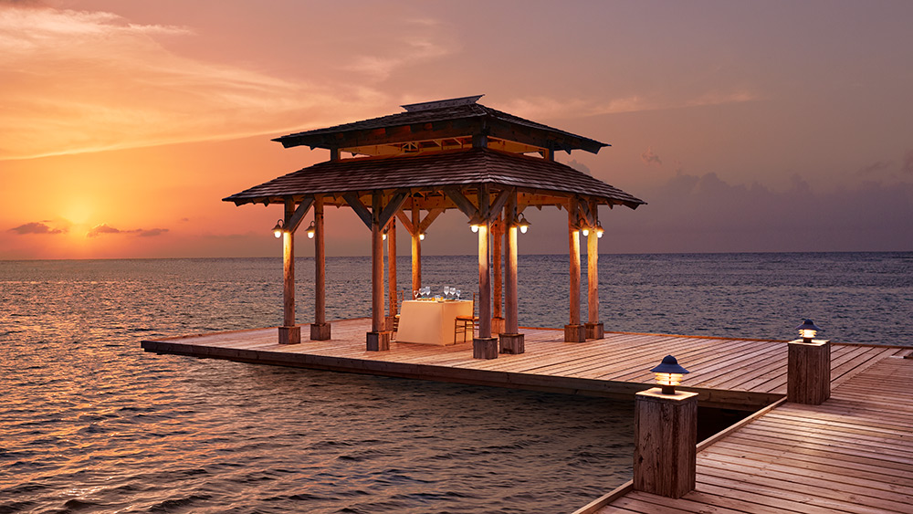 Private dining in the gazebo at sunset at Zoetry Montego Bay
