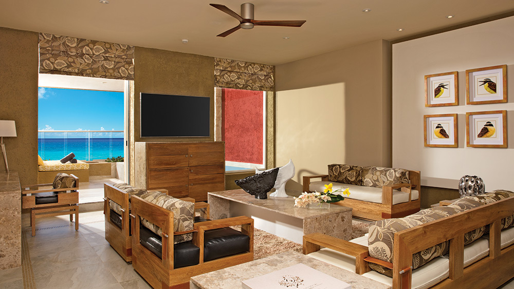 Living room of the Impression Ocean Front One Bedroom Suite with Plunge Pool at Zoetry Paraiso de la Bonita