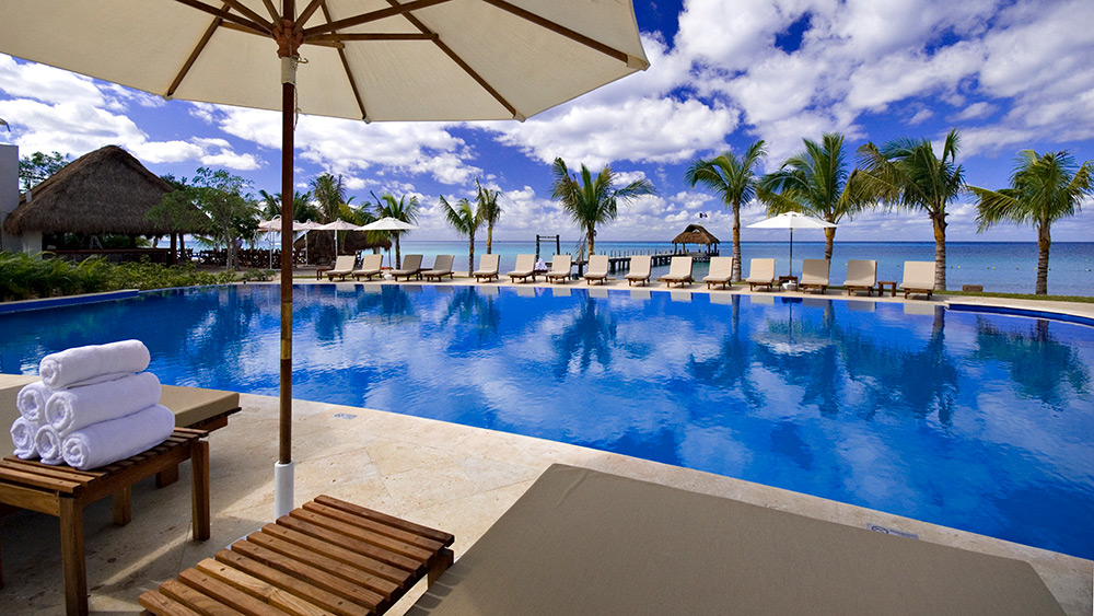 Infinity pool for Preferred Club guests at Secrets Aura Cozumel