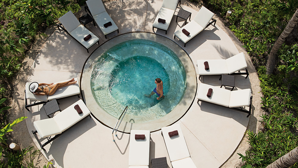 Couple in the Jacuzzi at Secrets Akumal
