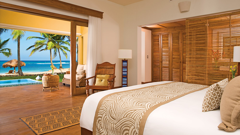 Bedroom of the Junior Suite Deluxe Ocean Front at Zoetry Agua Punta Cana