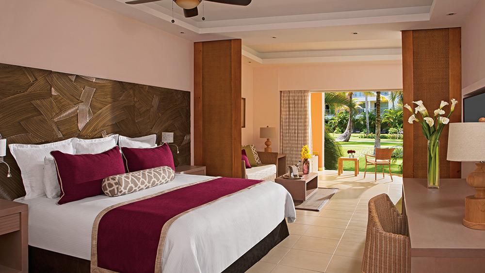 Bedroom of the Junior Suite Garden Terrace at Secrets Royal Beach Punta Cana
