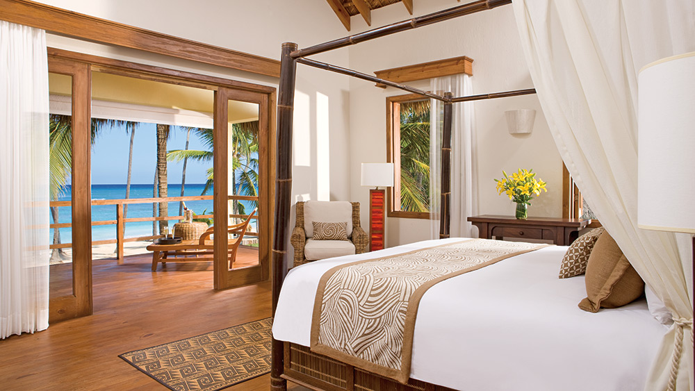 Bedroom of the Junior Suite Ocean Front at Zoetry Agua Punta Cana
