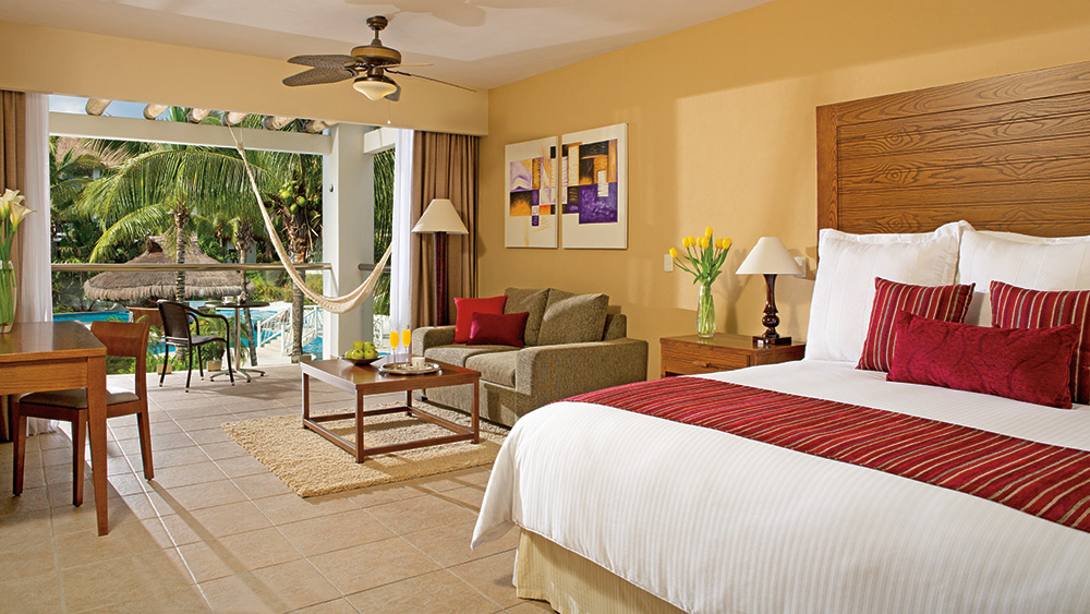 Bedroom of the Junior Suite Pool View at Secrets Aura Cozumel