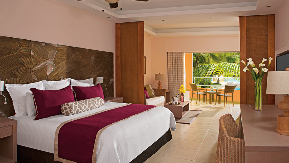 Bedroom of the Junior Suite Pool View at Secrets Royal Beach Punta Cana