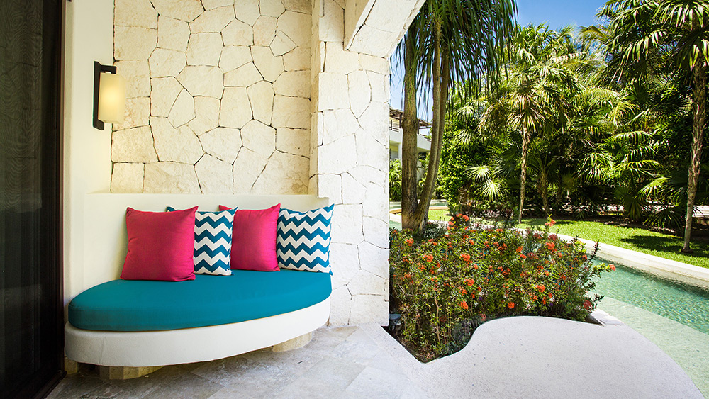 Terrace with pool access in the Junior Suite Swim Out at Secrets Maroma Beach Riviera