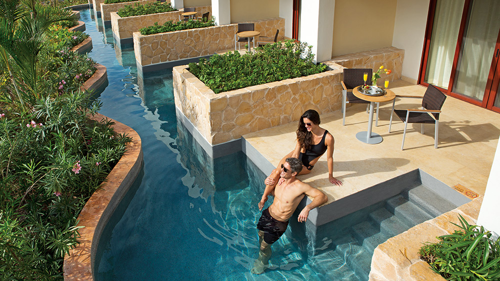 Couple in the private pool of the Junior Suite Swim Out at Secrets Playa Mujeres