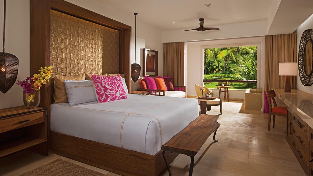 Bedroom of the Junior Suite Tropical View at Secrets Akumal
