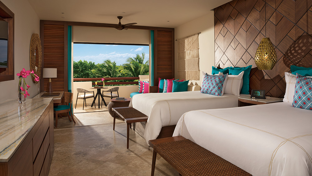 Two double beds in the Junior Suite Tropical View at Secrets Maroma Beach Riviera