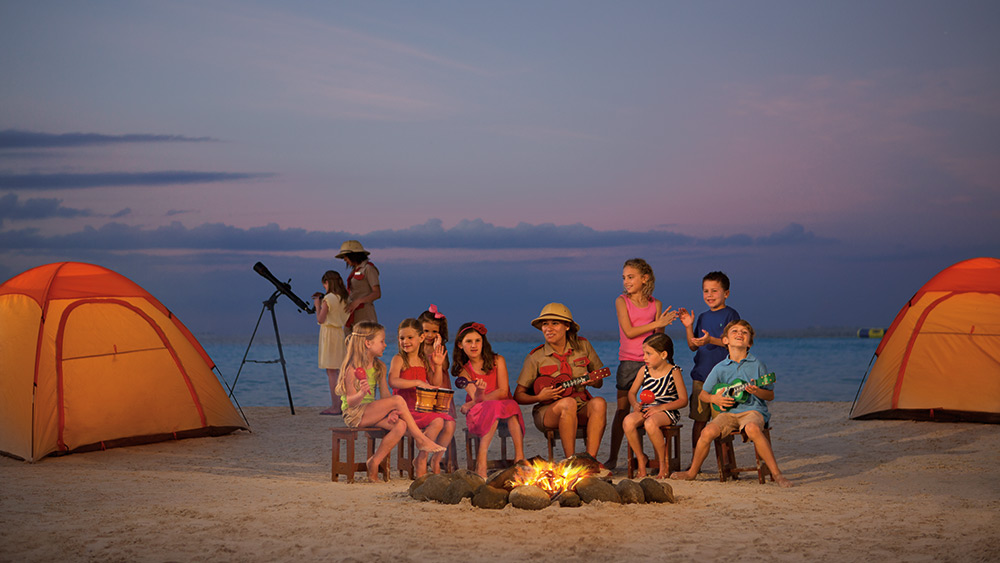Children at a campfire on the beach at Dreams Sands Cancun