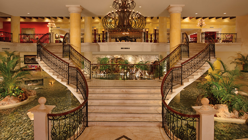 Grand staircase in the lobby of Secrets Capri Riviera