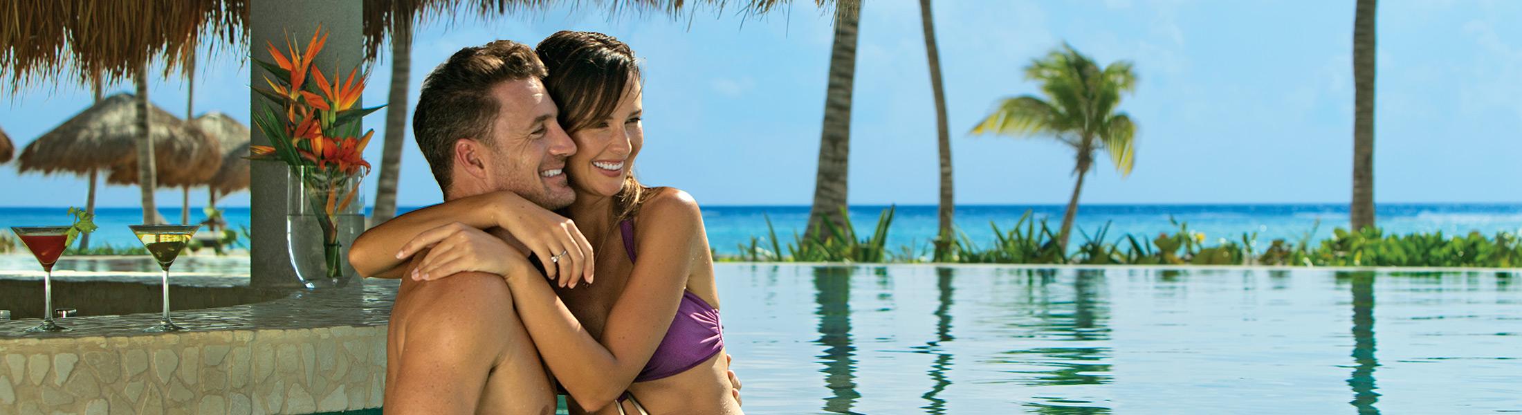 Couple at the swim up bar at Secrets Akumal