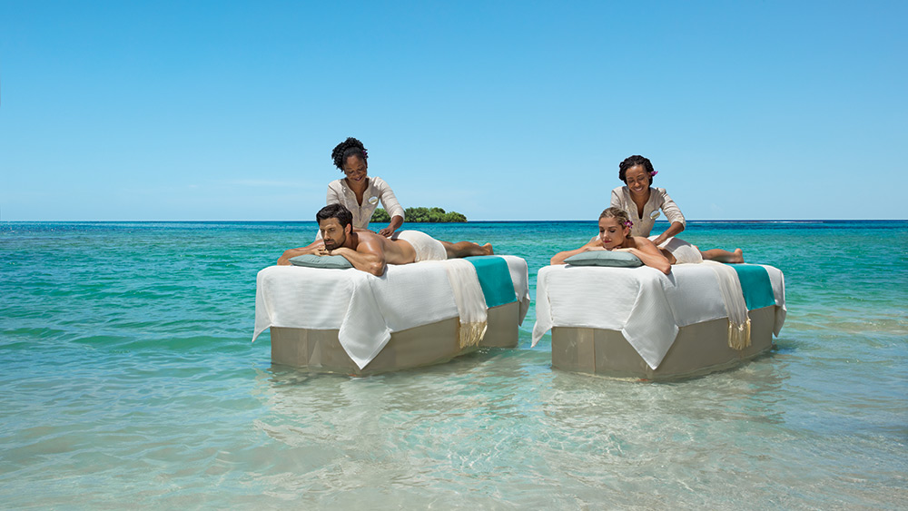Couple having a massage in the Caribbean Sea at Zoetry Montego Bay