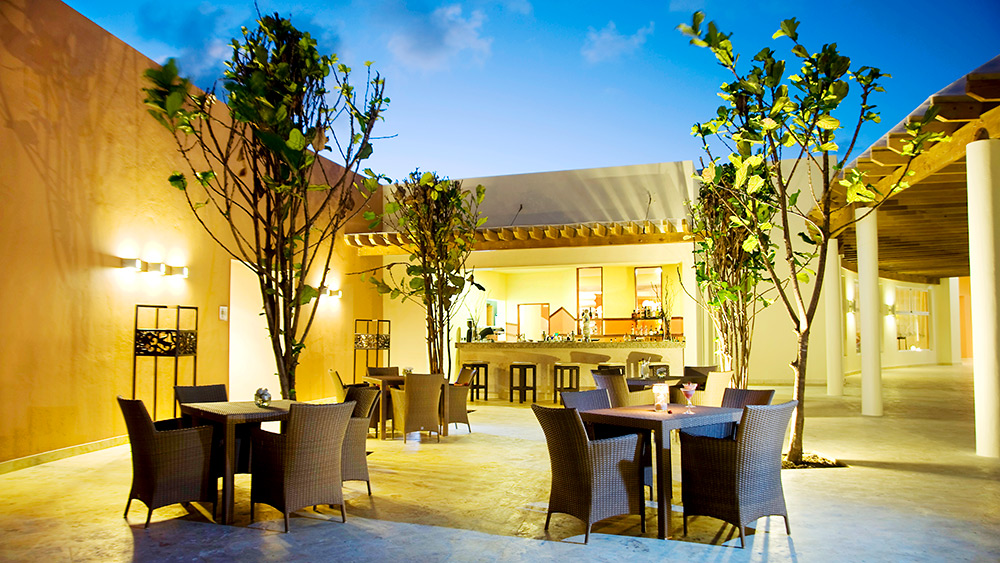 Outdoor dining area at Secrets Royal Beach