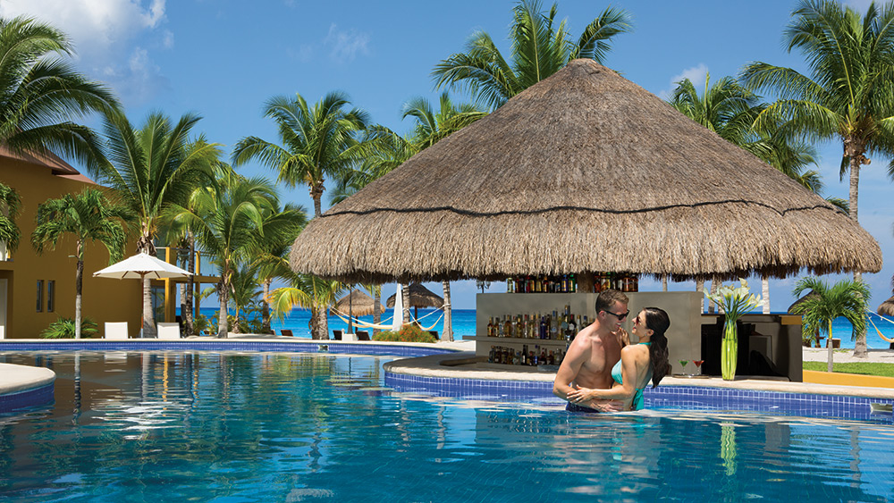 Couple in the pool at Secrets Aura Cozumel