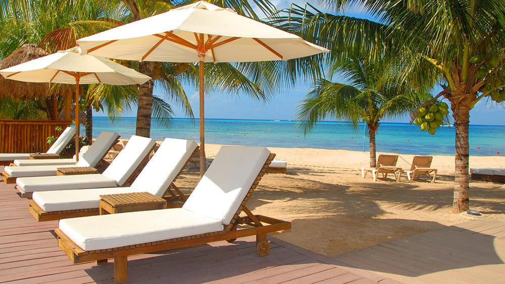 Sun loungers near the beach at Secrets Aura Cozumel