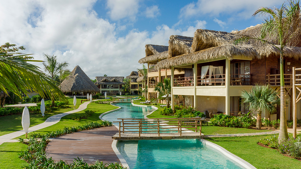 Winding pool past suites at Zoetry Agua Punta Cana