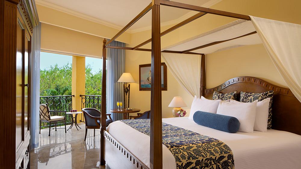 Bedroom of the Preferred Club Deluxe Tropical View at Secrets Capri Riviera