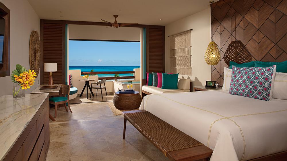 Bedroom of the Preferred Club Junior Ocean Front at Secrets Maroma Beach Riviera
