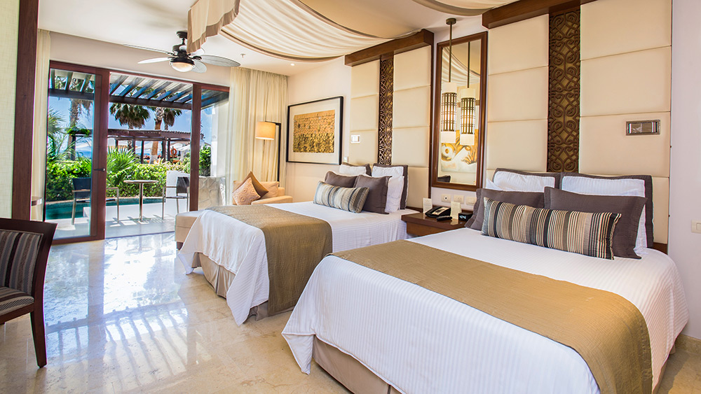 Double beds in the Preferred Club Junior Suite Ocean View Swim Out at Secrets Playa Mujeres