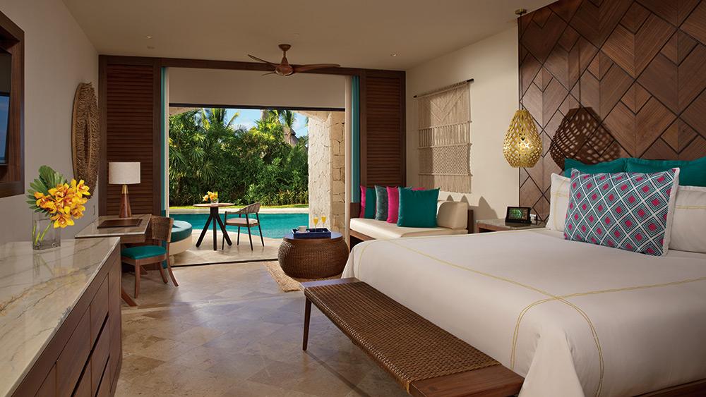 Bedroom of the Preferred Club Junior Suite Swim Out at Secrets Maroma Beach Riviera