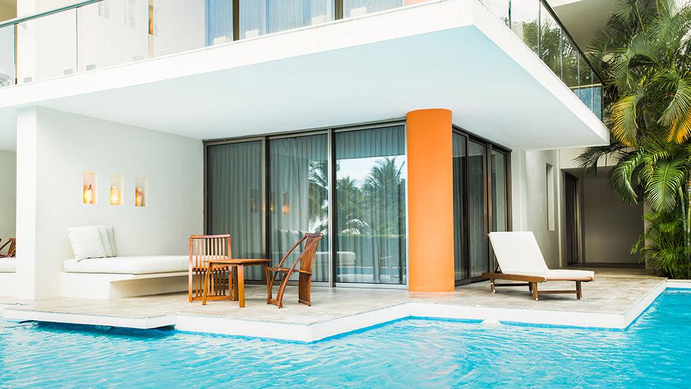 Direct pool access in the Preferred Club Junior Suite Swim Up Ocean View at Secrets Aura Cozumel