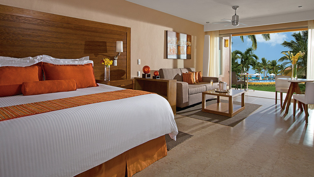 Bedroom of the Preferred Club Junior Suite Tropical View at Secrets Aura Cozumel