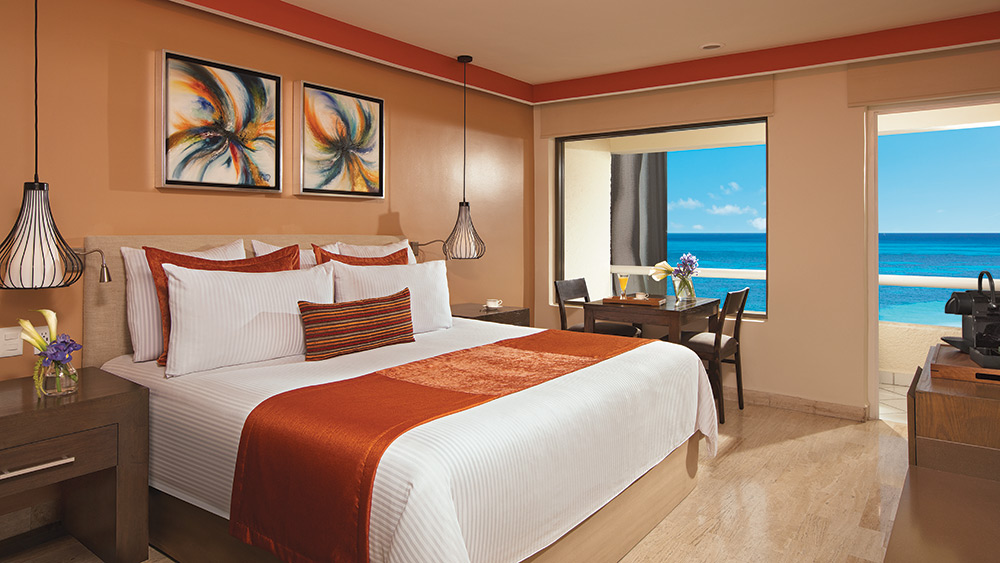 Bedroom of the Preferred Club Ocean Front Room at Dreams Sands Cancun