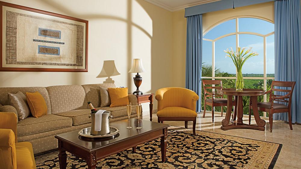 Living Room of the Preferred Club One Bedroom Honeymoon Suite Tropical View at Secrets Capri Riviera