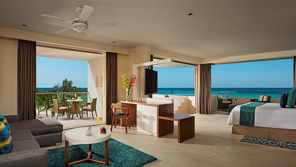 Living room of the Preferred Club Rooftop Ocean View Suite with plunge pool at Secrets Aura Cozumel