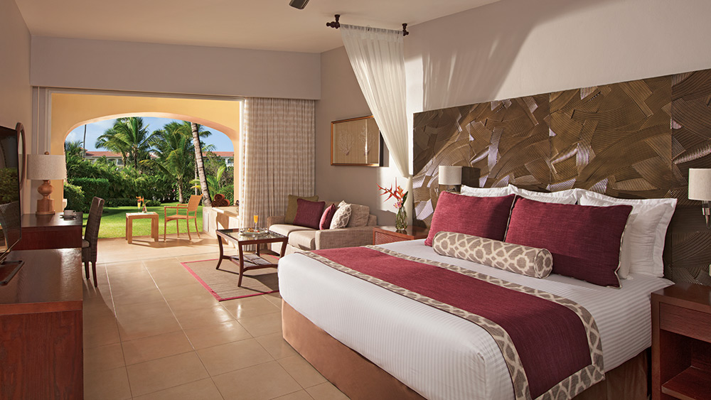 Bedroom of the Preferred Club Junior Suite Tropical View at Secrets Royal Beach Punta Cana