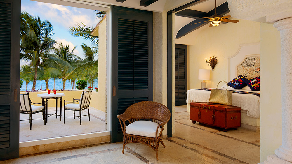 Living room of the Romance Ocean Front One Bedroom Suite with Terrace at Zoetry Paraiso de la Bonita