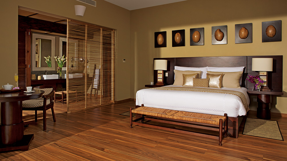 Bedroom of the Romantic Junior Suite Garden View at Zoetry Agua Punta Cana