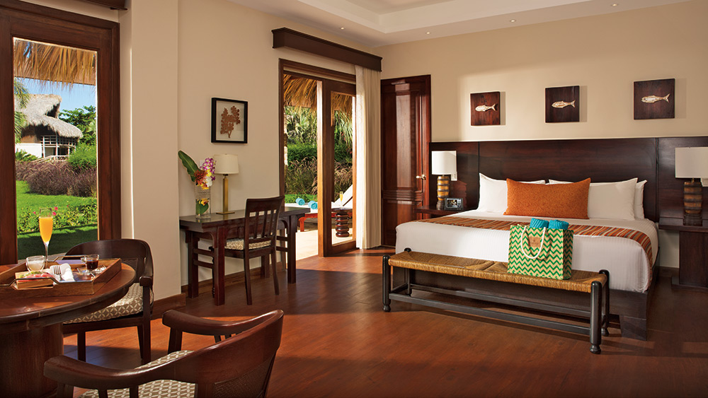 Bedroom of the Romantic Junior Suite Taino Garden View at Zoetry Agua Punta Cana
