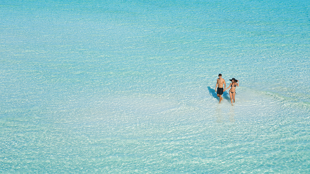 Couple in the sea at Dreams Sands Cancun