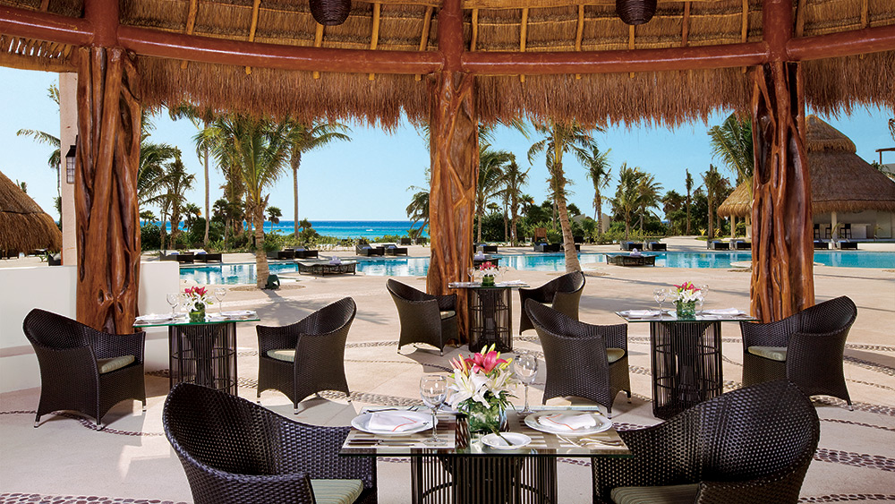 Open air dining in Seaside Grill at Secrets Maroma Beach Riviera