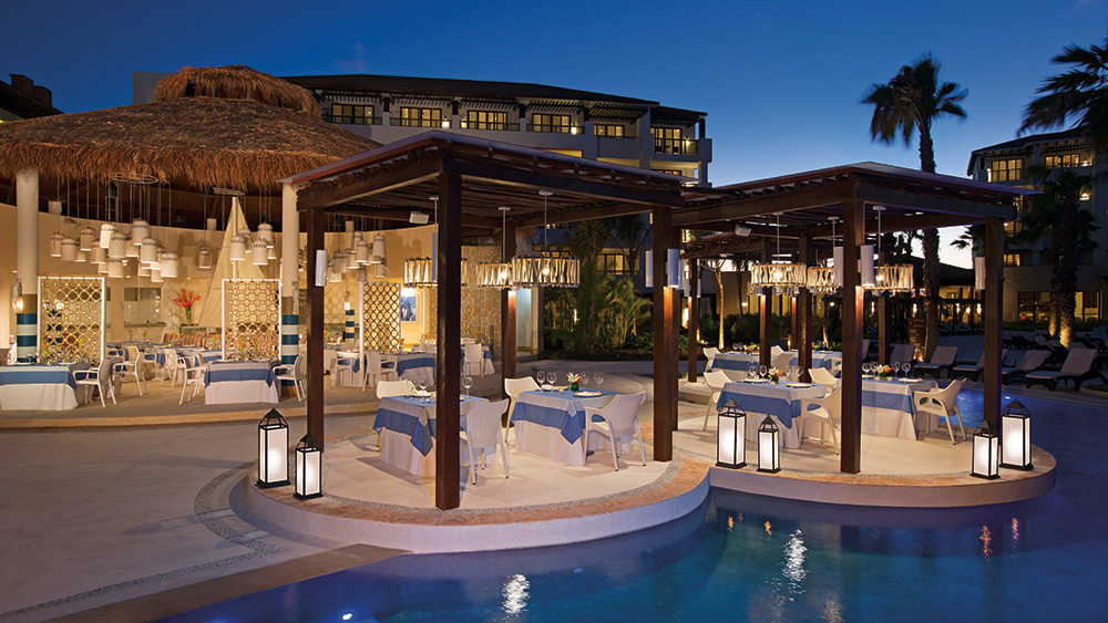 Outdoor dining at Seaside Grill at Secrets Playa Mujeres
