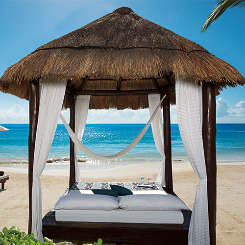 Balinese daybed on the beach at Secrets Capri Riviera